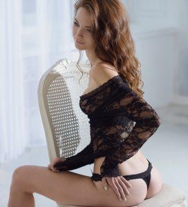 Beautiful sexy lady in elegant black panties and bra